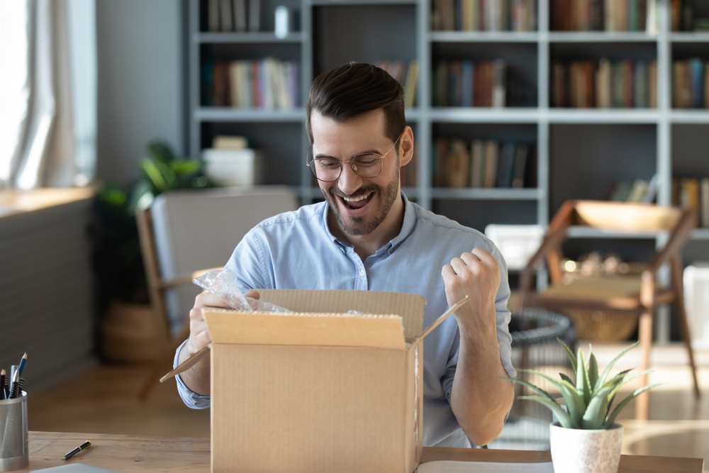 a man opened a box with excitement